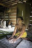Woman preparing sago, Baitari, 38 years old, Pulau Siberut, Sumatra, Indonesia