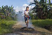 Boy jumping over the fire, Pulau Siberut, Sumatra, Indonesia