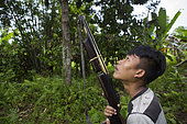 Boy hunting with a rifle, Pulau Siberut, Sumatra, Indonesia