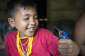 Kingfisher (Alcedo meninting) caught in a trap by a child, Pulau Siberut, Sumatra, Indonesia