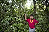 Laeru, 9, in the rainforest of Pulau Siberut, Sumatra, Indonesia