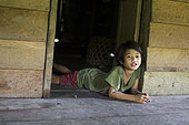 Girl lying on the floor, Pulau Siberut, Sumatra, Indonesia