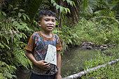 Child returning from school at 2 hours walking, Pulau Siberut, Sumatra, Indonesia