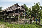 Children going to class in Sekolah Patas, unofficial school, non governmental, Pulau Siberut, Sumatra, Indonesia