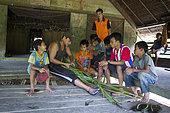 Teacher and students at the Sekolah Patas, an unofficial, non-governmental school , Pulau Siberut, Sumatra, Indonesia
