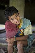 Boy at the Sekolah Patas, an unofficial, non-governmental school, Pulau Siberut, Sumatra, Indonesia