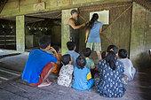 Mathematics exercise at the Sekolah Patas,an unofficial, non-governmental school, Pulau Siberut, Sumatra, Indonesia