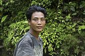 Portrait of Ogai, 24 years old producer of patchouli oil, Pulau Siberut, Sumatra, Indonesia