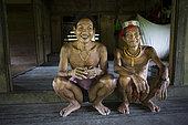 Amantari, 39 years old and his father, Pulau Siberut, Sumatra, Indonesia