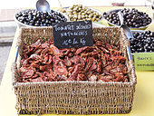 Dried tomatoes and olives on a market of Provence in summer, France