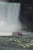 "Tour boat, ""Maid of the Mist"", at Niagara falls, Horseshoe falls Canada in backgroung, American falls in foreground"
