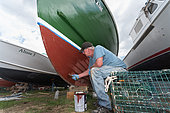 Working on lobster boats in the Spring. Chebeague Island, Casco Bay, Maine