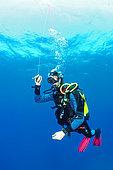 Diver performing his decompression stop, Antheors Péniches dive site, Côte d'Azur, France