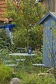 Garden furniture: table, chair. Scarecrow. Mainly blue garden. France