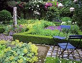 Aromatic garden: Oregano (Origanum vulgare), Rosemary (Rosmarinus officinalis), Bay laurel (Laurus nobilis), Common Stork's Bill (Erodium cicutarium), Pansy (Viola sp), Mme Deferme's garden, Belgium