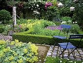 Flowering aromatic garden and water pump in summer, Mme Deferme private garden, Belgium