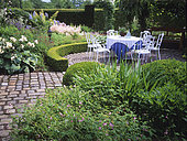 Flowered terrace: Geranium (Geranium sp), Rose (Rosa sp), Astilbe (Astilbe sp), Hosta (Hosta sp), Boxwood (Buxus sp), Private garden, Mr and Mrs Deferme, Belgium