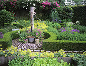 Flowered aromatics garden with water pump, Mme Deferme's garden, Belgium