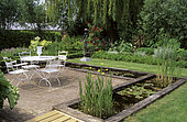 Terrace : Garden furniture surrounded by a pond, Aquatic plants, Private garden, Belgium