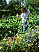 Young girl weeding in a vegetable patch