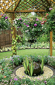 Garden scene: Spherical fountain under arbor and suspension of various plants ... RHS Garden Wisley, Surrey, Angleterre