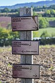 Signpost of the Bard Source and the Fairy Chimney Trail in the Valley of the Saints. Auvergne, France