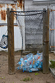 Net for recycling plastic bottles, La Désirade, Guadeloupe
