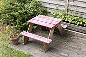 Wooden garden table for children on a garden terrace, summer, Pas de Calais, France