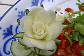 Food carving, making flowers from fruit and vegetables for salad