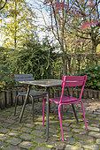 Dining area on a garden terrace, autumn, Somme, France