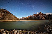 Electric river and mountain range at night, Patagonia, Argentina