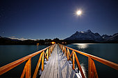 Wooden walkway on a lake at night, Torres del Paine, Patagonia, Chile