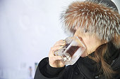 Woman drinking in an ice glass, Ice Hotel, Quebec, Canada