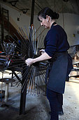 Frédérique Fert installing the machine used to make a scourtin, Nyons, Provence, France