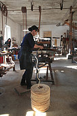 Frédérique Fert making a scourtin with coconut thread, Nyons, Provence, France