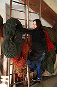 Sophie Fert carrying colored coconut threads, Nyons, Provence, France
