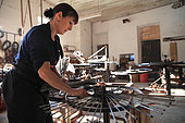 Frederique Fert et Machine used to make a scourtin, Nyons, Provence, Francem