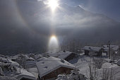 Parhelia (phenomenon of atmospheric optics due to the reflection of sunlight on small ice crystals present in some clouds). Chamonix, Savoy, Alps, France