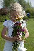 Girl holding annual flowers