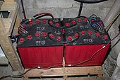 Four large 12v lead acid batteries for storing wind generated electricity wired as 24 volt UK