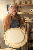 Potter presenting a mold in his workshop, Martine Gilles and Jaap Wieman, Village of Brantes, Provence, France