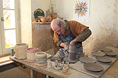 Potter working on a clay piece, Martine Gilles and Jaap Wieman, Village of Brantes, Provence, France