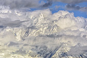 Bionnassay needle under clouds at dusk on a stormy evening, Mont Blanc Massif, Alps, France