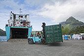 Loading a container in Bora Bora on the Cargo Container ship Hawaiki nui connecting Bora Bora to Tahiti, Society Islands, Leeward Islands, French Polynesia