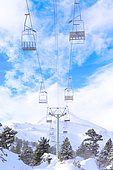 Snowy landscape and chairlifts, ski resorts and winter sports in mountain areas, Station Pierre Saint Martin, municipality of Arette (64), Pyrenees, France