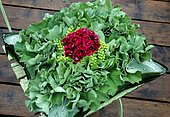 Floral cushion decoration with Lady's mantle leaves and flowers