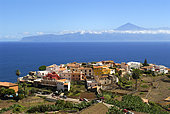 Village of Agulo with the Teide (Tenerife) in the background, Island of La Gomera, Canary Islands.
