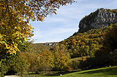 Reculee and the rocks of La Chatelaine with ruins of the medieval castle above the cave, Cirque du Fer à Cheval, Les Planches Pres Arbois, Jura, France