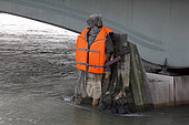 Photographer Yann Arthus-Bertrand dressed the zouave of the Alma bridge with a lifejacket to wake up the consciousness of global warming during the flood of the Seine in Paris in February 2018, France