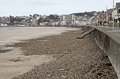 Absence of sand due to a storm that swept everything to reveal only the pebbles in Val-André, Brittany, France